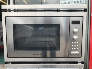 NEARLY NEW SMEG built in microwave