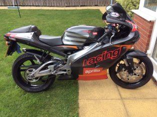Motorbike with race exhaust Aprilia RS125