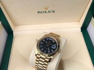 For sale Rolex Day Date 40 Black Motif Dial Yellow Gold President