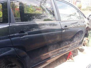 Black Toyota corolla verso door