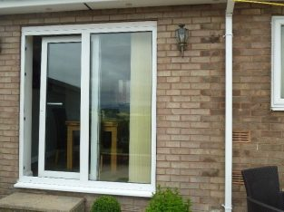 Good condition White tilt and slide patio door