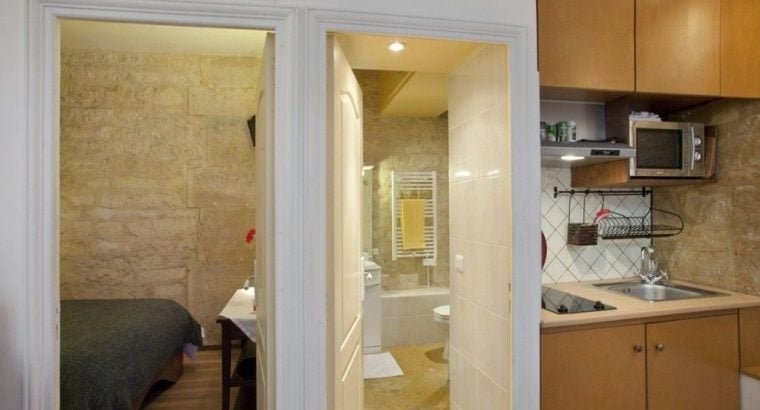 fully furnished one bedroom apartment has a modern, well appointed galley kitchen